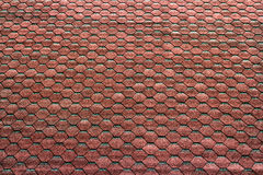 Red hexagonal tiles on the roof as a background Royalty Free Stock Images