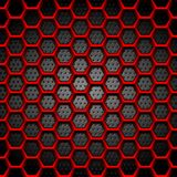 Red hexagons texture on dark perforated background Royalty Free Stock Image