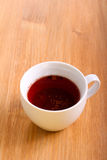 Red hibiscus tea in a cup Stock Photo