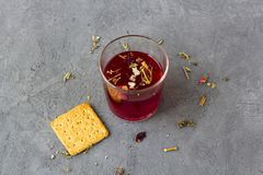 Red hibiscus tea in a glass cup stock images