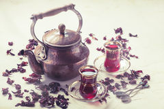 Red Hibiscus tea in turkish style. On stone background Stock Image