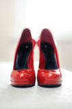 Red high-healed shoes Royalty Free Stock Photography