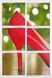 Red high heel shoe in window Royalty Free Stock Image