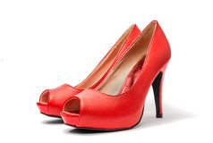 Red Peep Toes. Red high heel shoes in front of white clean background with shadows Stock Photography