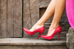 Red high heel shoes. And pink skirt royalty free stock images