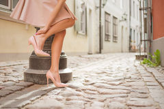 Red high heel shoes. And pink skirt stock images