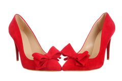 Red high heel women shoes. Isolated on white. Beautiful red shoes with bow Royalty Free Stock Photos