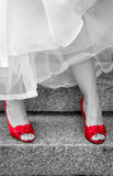 Red high heeled shoes. Black and white photo with woman wearing red high heeled shoes Royalty Free Stock Images