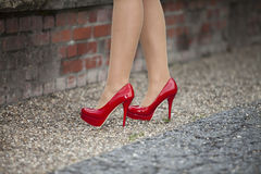 Red high heels. Woman legs in red high heels Royalty Free Stock Photography