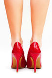 Red high heels. Sexy legs in red high heels  on white background Stock Image