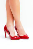 Red high heels. Sexy legs in red high heels  on white background Royalty Free Stock Photo