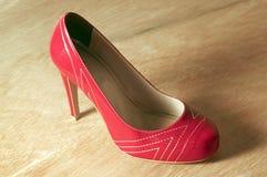 Red high heels. In wood floor Stock Photo
