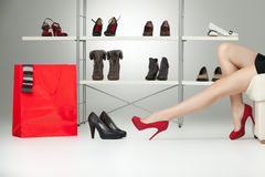 Red high heels on long legs Royalty Free Stock Image