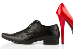 Red high heels and men's shoe Royalty Free Stock Images