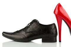 Red high heels and men's shoe Stock Photo