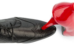 Red high heels and men's shoe. Ladies shoe men's shoe, symbol photo for separation, divorce and conflict Royalty Free Stock Image