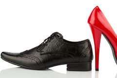 Red high heels and men's shoe Royalty Free Stock Image