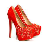 Red high heels shoes in rivets and rhinestones Royalty Free Stock Images