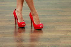Red high heels spiked shoes on female legs Royalty Free Stock Photo