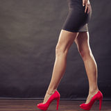 Red high heels spiked shoes on sexy female legs Royalty Free Stock Image