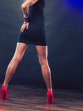Red high heels spiked shoes on sexy female legs Stock Images