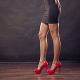Red high heels spiked shoes on sexy female legs Royalty Free Stock Images