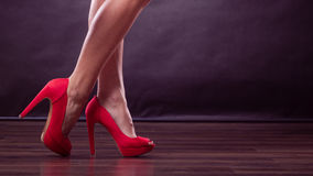 Red high heels spiked shoes on sexy female legs Stock Image