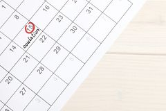 Red highlighter with ovulation day mark on calendar, stock images