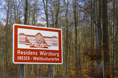 Red highway sign with a ilustration of historic place in Bavaria, Germany, part UNESCO World Heritage Site - Residenz. A red highway sign with a ilustration of Royalty Free Stock Photo
