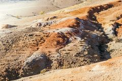 Red hills and the mountains in the fall. Colorful rocks, a journey through the mountains of Altai Stock Photo