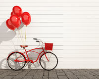 Red hipster bicycle with balloons in front of wall Stock Images