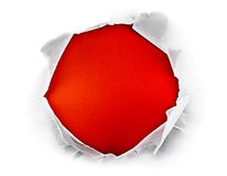 Red hole. Circle shape breakthrough paper hole with red background Royalty Free Stock Images