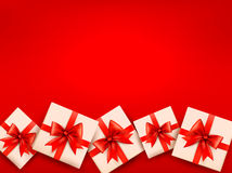Red holiday background with gift boxes Stock Images