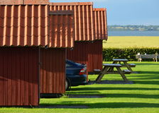 Holiday cottages with parked car Stock Photography
