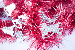 Red holiday decoration ribbon on white background Royalty Free Stock Photography