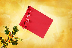 Red Holiday envelope. Holiday  envelope on a hand painted gold background Royalty Free Stock Images