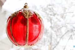 Red. Holiday ornament on a snowy day Royalty Free Stock Photography