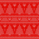 Red Holiday seamless pattern with cross stitch embroidered fir-tree and hearts. Royalty Free Stock Photo