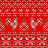 Red Holiday seamless pattern with cross stitch embroidered roosters. Christmas scheme design. Cocks - symbol of New Year 2017, xmas tree, heart and snowflake Stock Photography