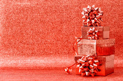 Red Holidays Decoration. Gifts with Ribbon Bow Stock Photo