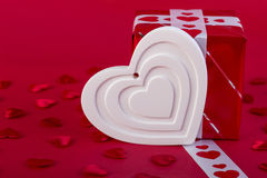 Red Holidays gift and white heart Royalty Free Stock Photos