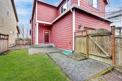 Red home exterior with wooden gate Royalty Free Stock Photos
