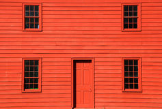 Red home. Four windows and door on red home Stock Image