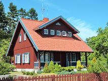 Red home in Nida, Lithuania Stock Photography