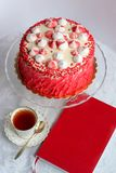 Red homemade cake decorated by hearts. Royalty Free Stock Photo