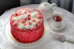 Red homemade cake decorated by hearts. Royalty Free Stock Photos
