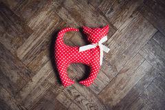 Red homemade cat toy with polka dots Royalty Free Stock Image