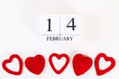 Red homemade diy heart made cardboard, yarn, wooden perpetual calendar on white background. Idea St. Valentines Day, day love,. February 14 concept. Copy space royalty free stock photography