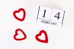 Red homemade diy heart made cardboard, yarn, wooden perpetual calendar on white background. Idea St. Valentines Day, day love,. February 14 concept. Copy space stock photos
