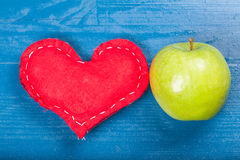 Red homemade heart green organic healthy apple blue wooden natur Stock Image